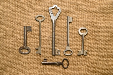 Six very old keys  on old cloth