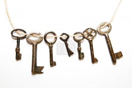 Photo for Some vintage keys from the locks on a white background - Royalty Free Image