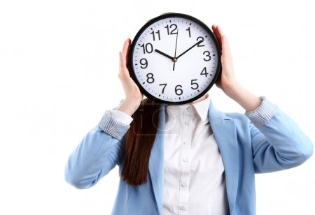 Portrait of beautiful young girl hiding face behind clock
