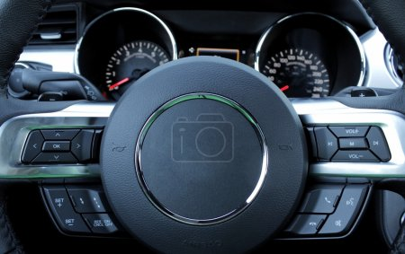 Dashboard and multifunction steering wheel inside the car detailed
