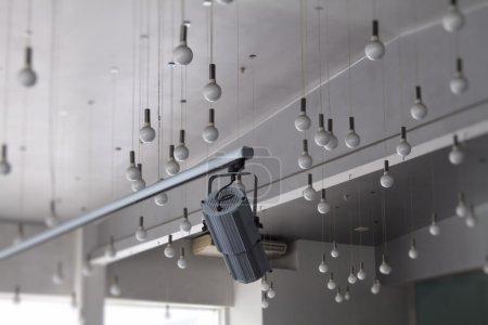 Studio lighting equipment. Controlled track spotlight on rail system