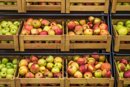 Wooden boxes of apples in the supermarket