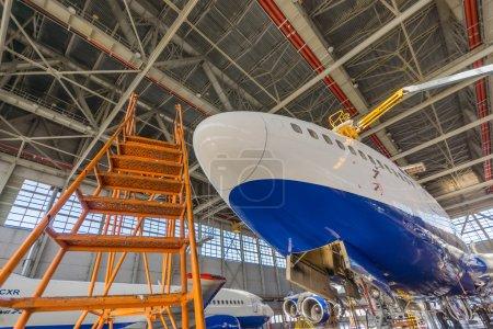 Passenger aircraft in the maintenance hangar
