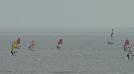 Athletes at the sailing courts floating in the waters of the city of Sochi on the Black Sea