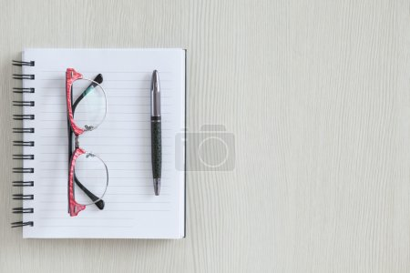 notebook, glasses and pen