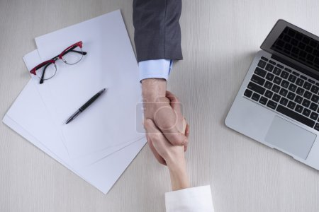 businessman and businesswoman hands holding