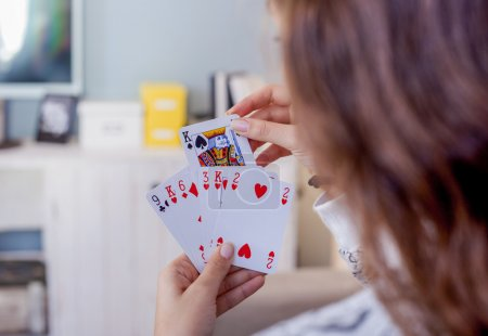 Woman playing with cards