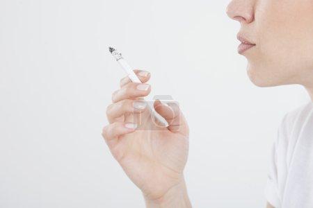Close up of smoking woman