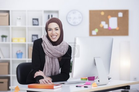 Beautiful Arabic business woman working in her office