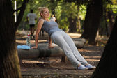 Beautiful girl in the park preparing for fitness training