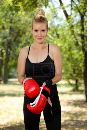 Girl boxer with gloves