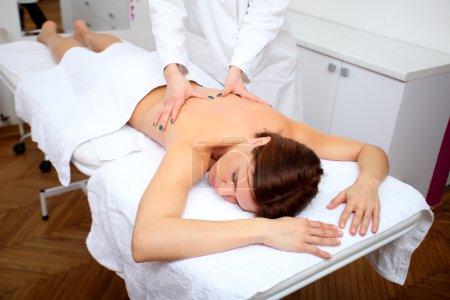 woman getting back massage