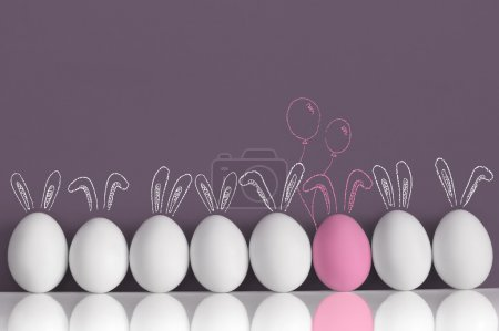 Pink bunny among white rabbits as Easter eggs