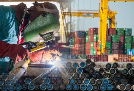 Worker welding the steel structure