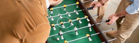 Cropped view of business people playing table soccer, banner