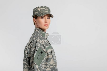 Photo for Woman in military uniform looking at camera isolated on grey - Royalty Free Image