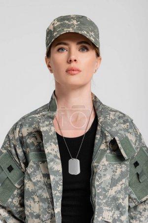 Photo for Woman in military uniform and dog tags on neck isolated on grey - Royalty Free Image