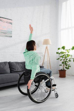 Brunette displeased woman training on wheelchair at home