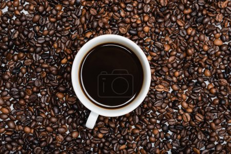 top view of cup with americano on coffee beans