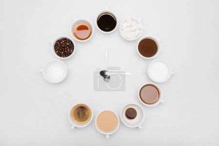 Photo for Top view of black and milky coffee in cups near beans and sugar cubes on white - Royalty Free Image