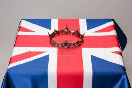 luxury royal crown on union jack flag isolated on grey