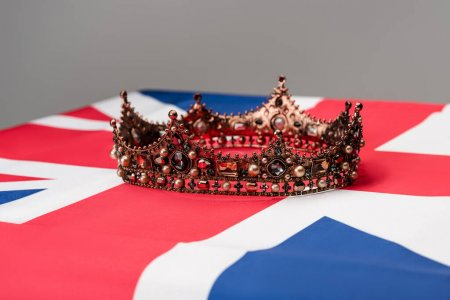 luxury royal crown on british flag isolated on grey