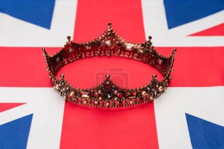 golden royal crown on british flag