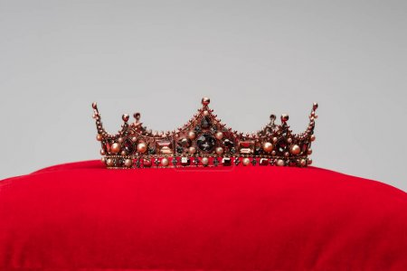 Photo for Luxury crown on red velvet cushion isolated on grey - Royalty Free Image