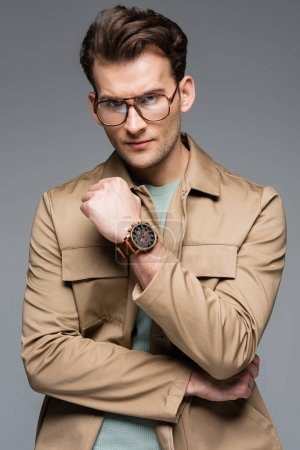 Photo for Stylish man in jacket and glasses isolated on grey - Royalty Free Image