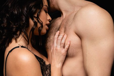 brunette and passionate woman touching muscular man