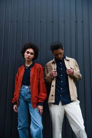 stylish african american couple posing outside