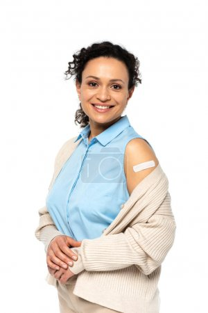 Photo for Smiling african american woman with adhesive plaster on arm isolated on white - Royalty Free Image