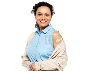 Photo for Cheerful african american woman with medical plaster on arm isolated on white - Royalty Free Image