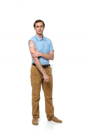 Man with adhesive patch on arm looking at camera on white background