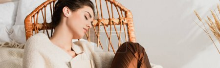 young woman sleeping in rocking chair with book, banner