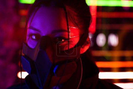Photo for Young asian woman in black gas mask looking at camera - Royalty Free Image