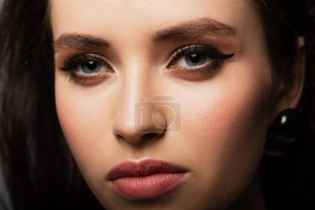 close up of brunette and young model with makeup