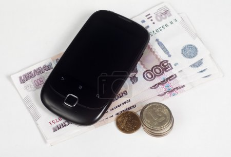 Mobile payment. Cell Phone and Russian money