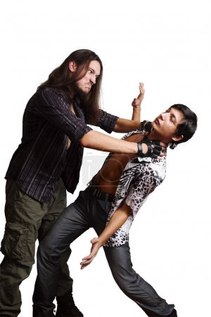 Angry rocker strangles glamor boy