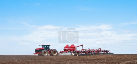 Tractor with seeder in the field