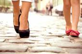 a woman with a girl go on the sidewalk