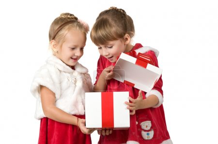 Christmas. Two little girls open white box