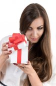 beautiful girl opening white box with a red bow. in the box is a
