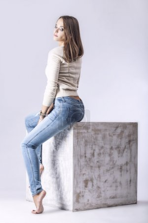 Model, woman in fashionable jeans and a jacket in full length in