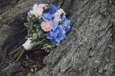 Bouquet wedding flowers blue with pink on  tree