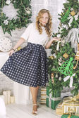 Beautiful woman in Christmas interior celebrates happy