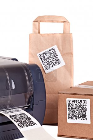 Barcode printer and packaging boxes marked with a bar code. Barc