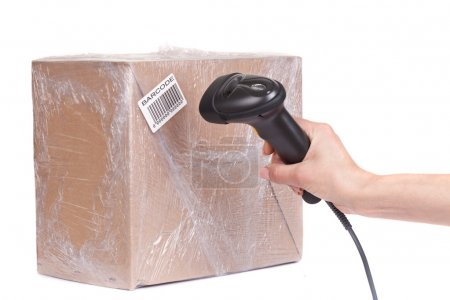 Closeup of the barcode scanner during scanning of boxes of goods