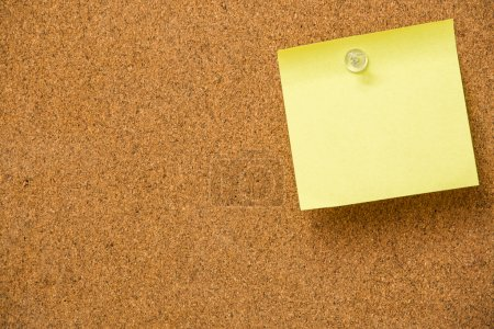 Photo for Yellow sticky notes on cork  board - Royalty Free Image