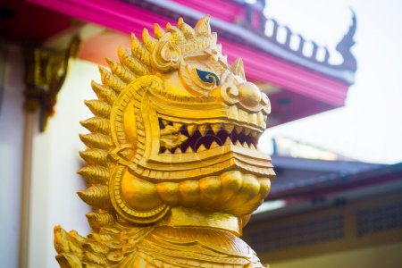 An antique golden lion made of stone